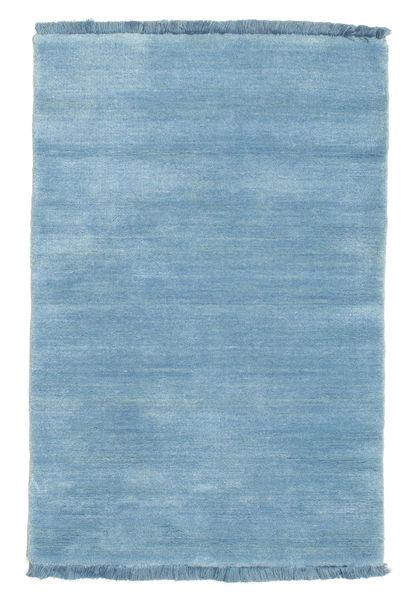 Handloom fringes - Lys blå teppe CVD5433