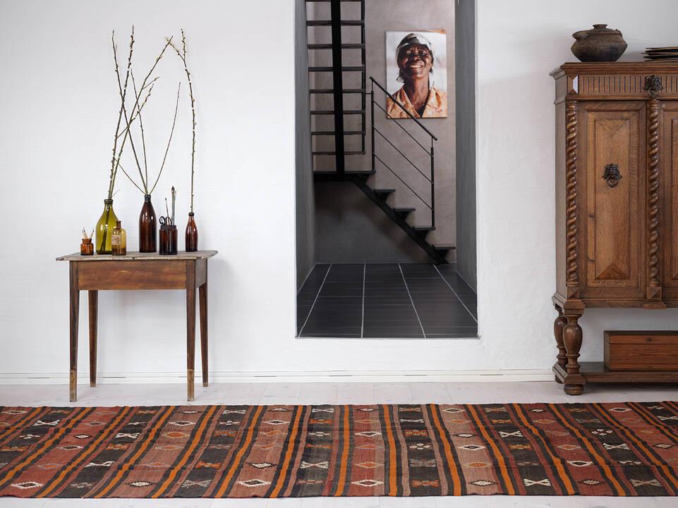 Brown / yellow  kilim semi antique turkish -  Carpet in a hallway.