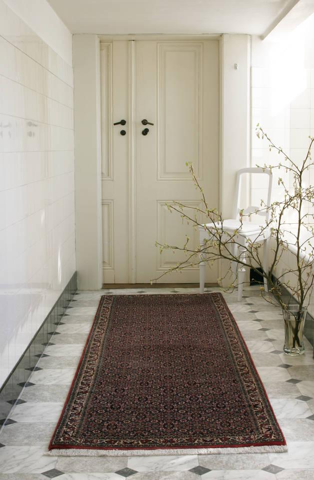 Red  bidjar -  Carpet in a hallway.