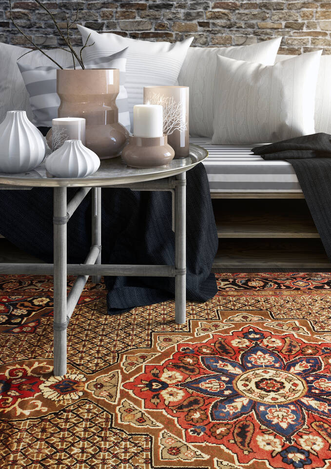 Rødt  koliai - teppe i en stue.