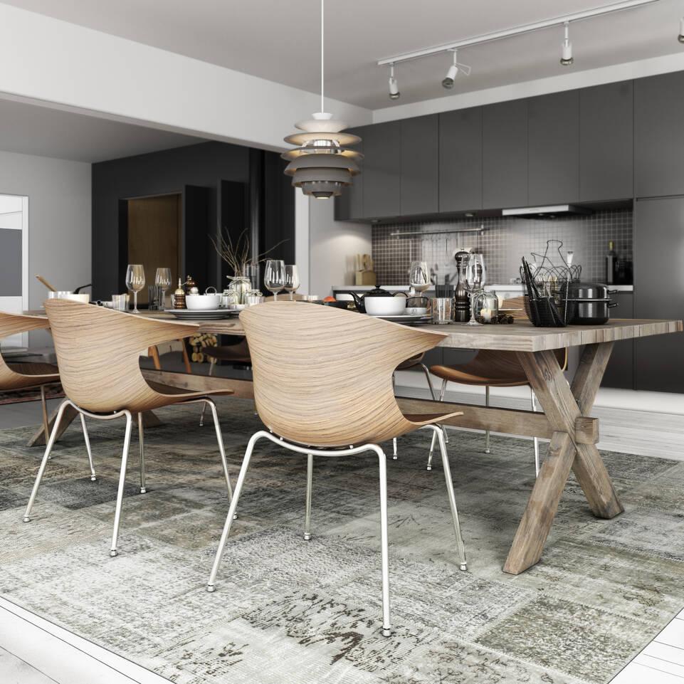 Fekete / szürke, hosszúkás patchwork - turkiet szőnyeg  egy konyha.