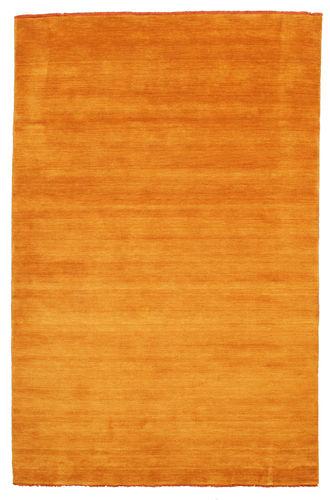 Handloom fringes - oransje teppe CVD5329